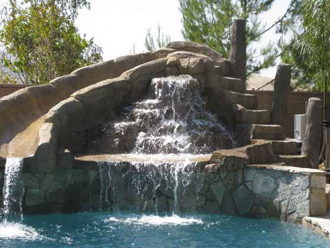 swimming pool slide with waterfall