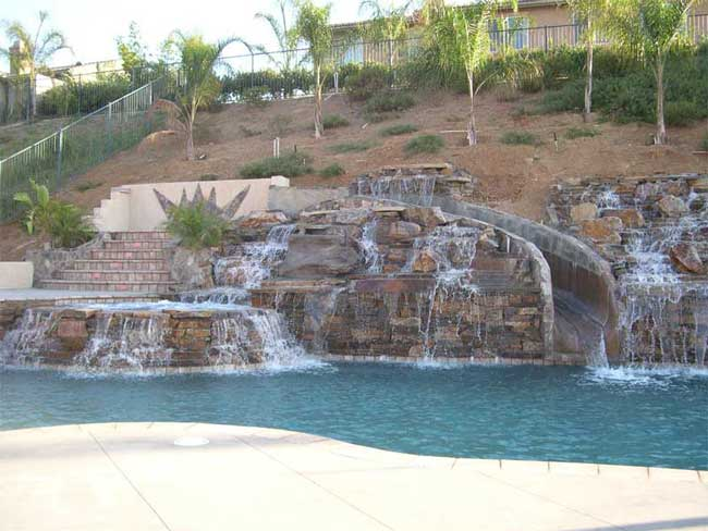 natural quartz boulder waterfalls slide vanishing edge pool - Swimming Pools With Waterfalls And Slide